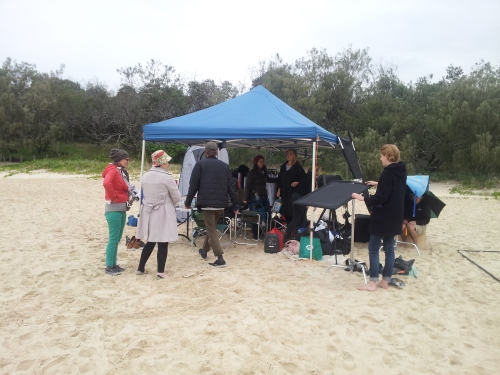 Noosa - The Sara crew and I waiting it out on the beach for the rain to stop
