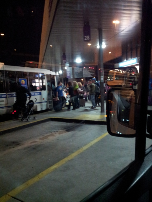 Atlanta, GA - People everywhere in the freezing cold wind awaiting shuttle buses to their hotels, put up by the airlines