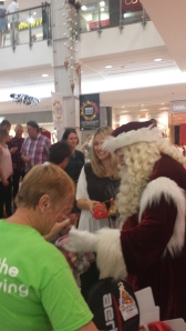 Santa Claus and I spreading some Christmas cheer
