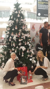 Xanthe Mallet & I placing our gifts under the Wishing Tree