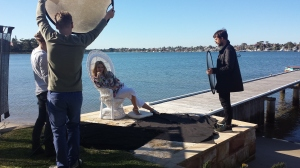 A cover try on the jetty and a white cane chair as a prop